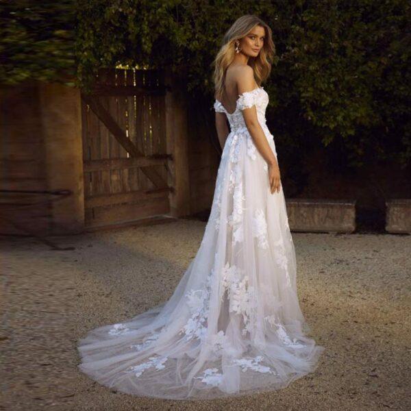 Robe De Mariée Princesse Fleurie Manche Tombante Blanche   Soirée Blanche
